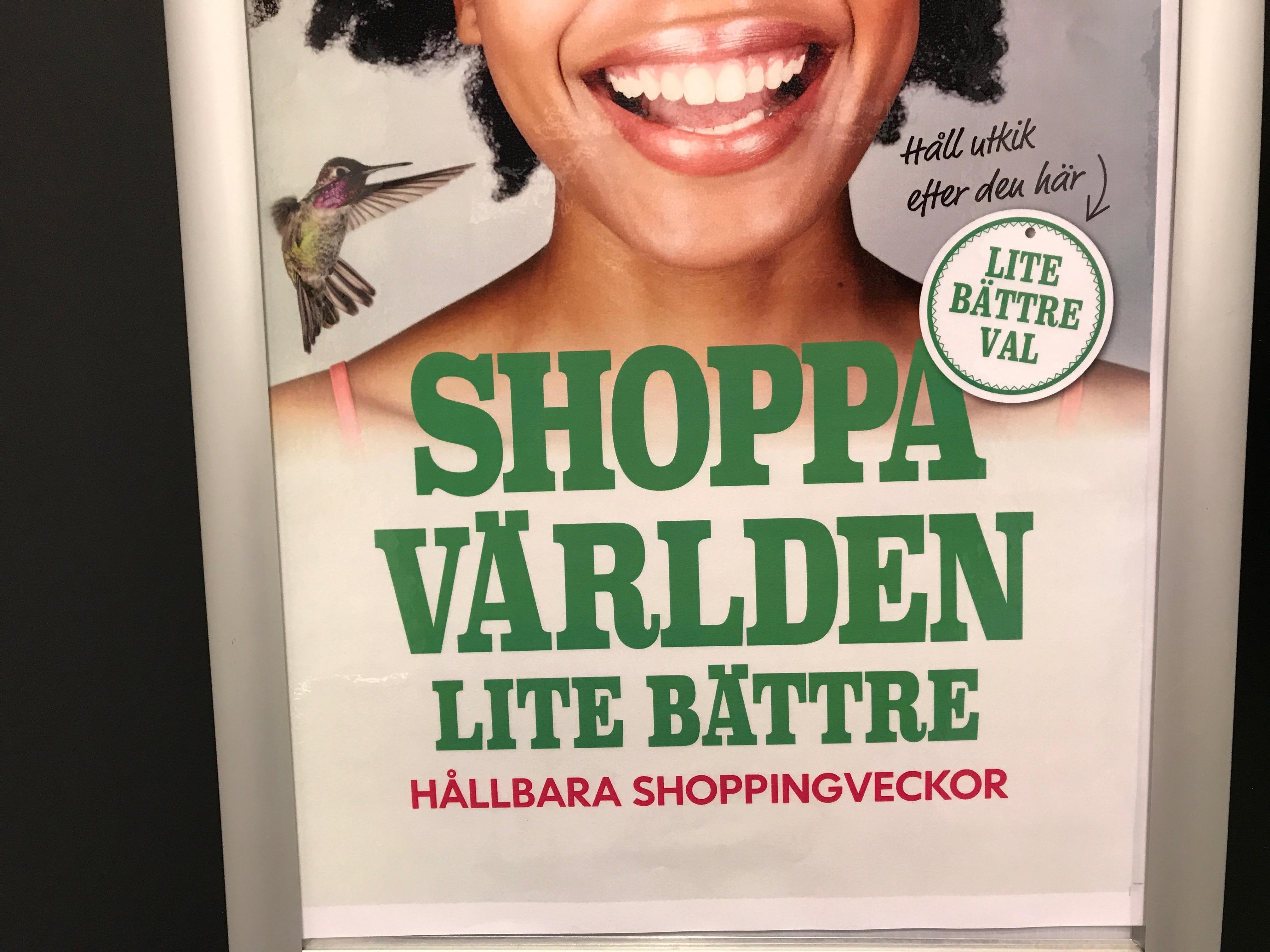 """Reklamaffisch med texten """"Shoppa världen lite bättre"""""""